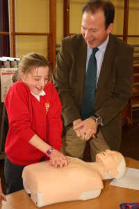 Pupil Shows Jesse Norman how to do CPR