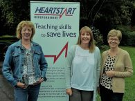 Sarah (centre) with Herefordshire Heartstart Trustees Jan Powell (left) and Cathy Matthews