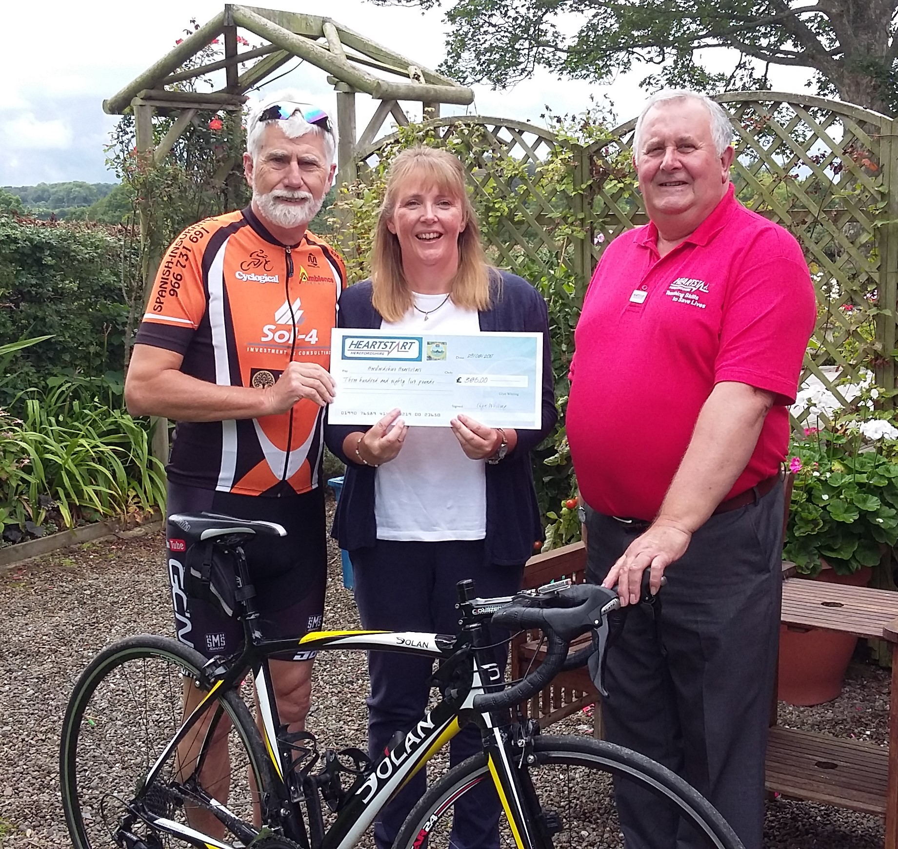 Glyn Whiting (fundraiser) with Herefordshire Heartstart Coordinator Sarah and Chair Of Trustees, Clive Edwards